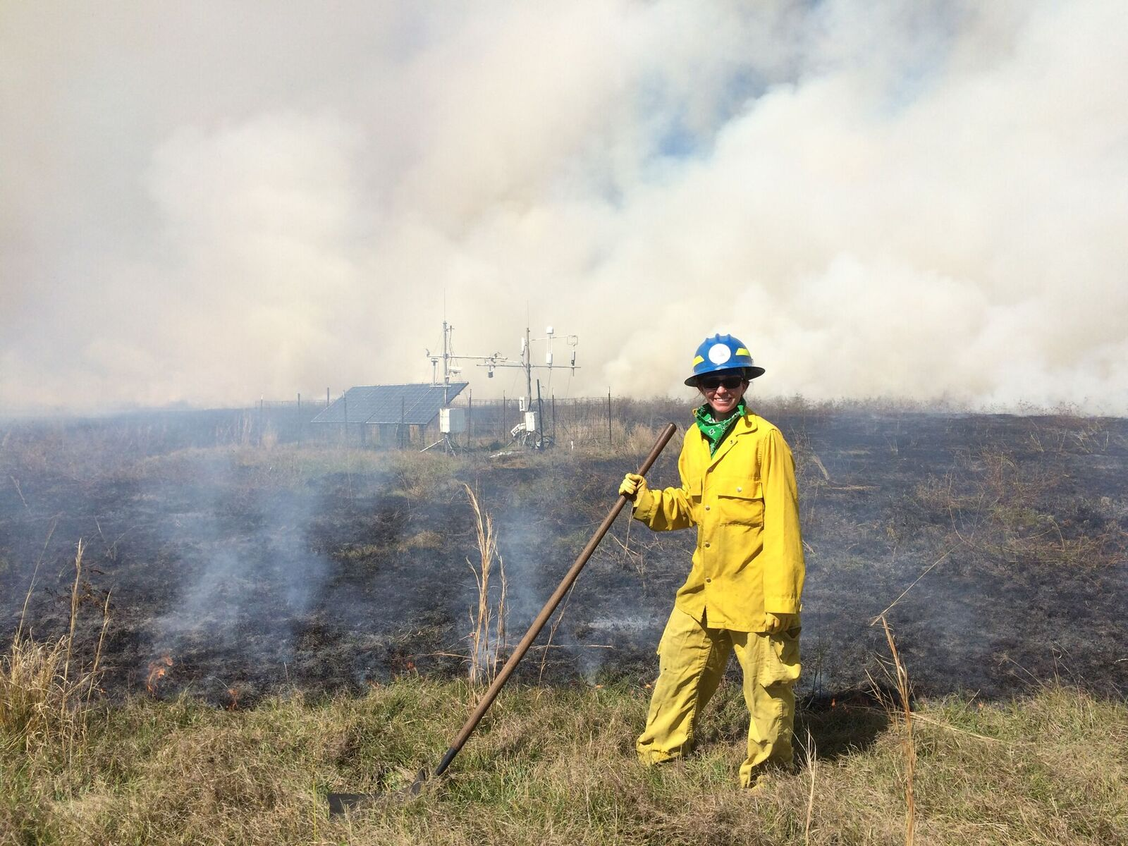 A pasture burn with an Eddy Flux tower in the background