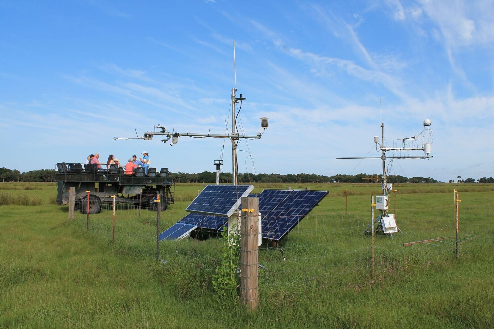 A swamp buggy tour passes an Eddy Flux tower at the MAERC site